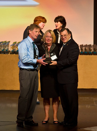 "EXIT Realty Virginia Receives 2011 Region of the Year Award: Tom and Nancy Shaver accept the ""Self Made Man"" representing the prestigious award"